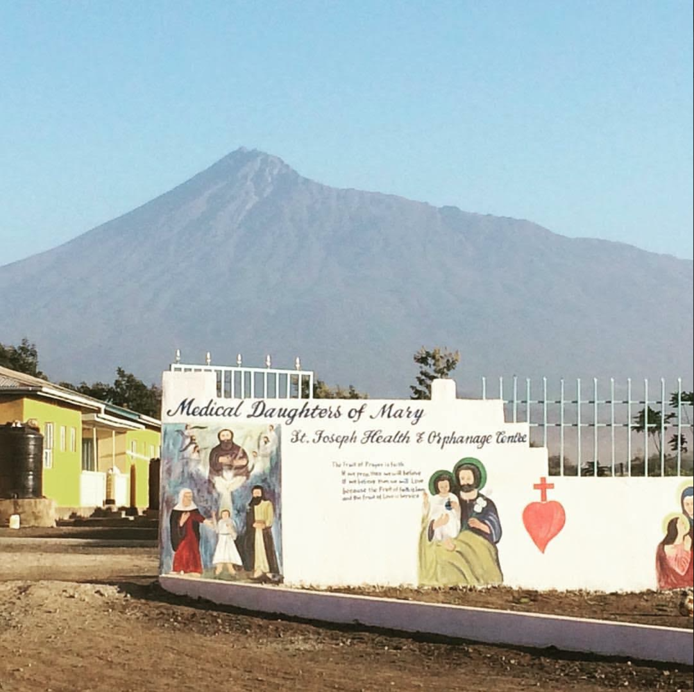 The new entrance to St. Joseph's Orphanage with Mt Meru in the distance.