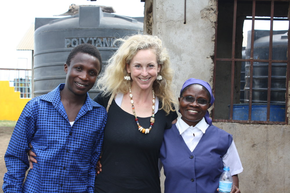 Unite Founder & Director Anne Wells with Sister Crispina Mnate and Godfrey at St. Joseph's Orphans Center.