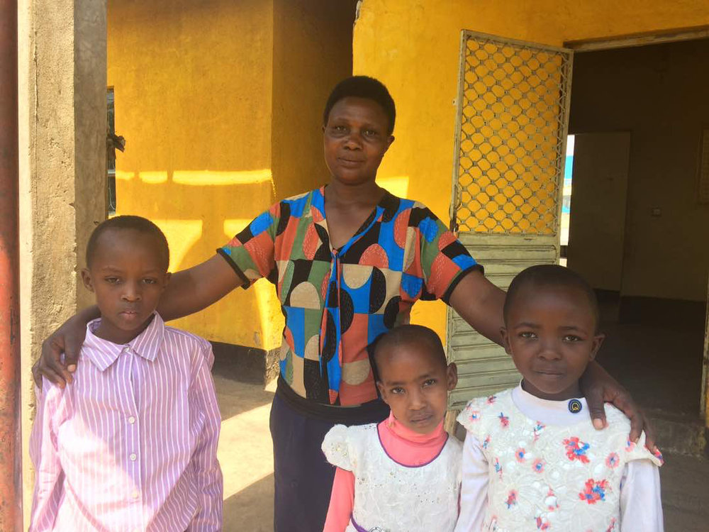 Mamee, pictured this week with three of the 48 orphans who currently call St. Joseph's home.