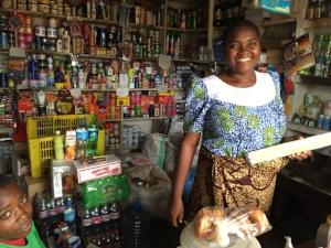 """Alice in her small """"duke"""" (general store) in Morogoro."""