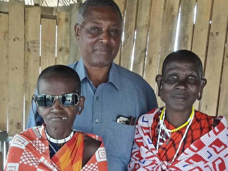 Dr. Gideon with two Maasai women who recently had surgeries sponsored by Unite. Namayani had cataract surgery and can now see well. She wears dark glasses for dust and sun protection. Mariam had surgery to remove a goiter. She will need a follow up surgery but is feeling strong and well.