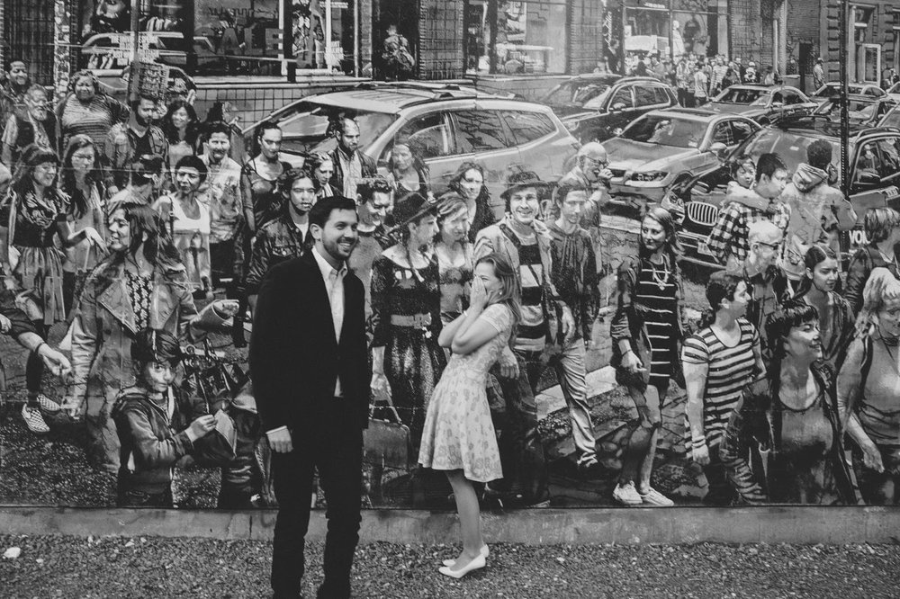 Engagement photos in front of mural on Bowery and Houston | Documentary wedding photography - blog.cassiecastellaw.com