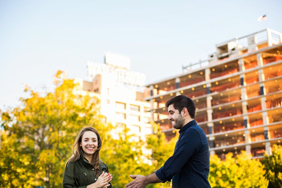 candid laughing engagement portrait, yellow fall leaves, blue sky, watchtower DUMBO Brooklyn Bridge Park - www.cassiecastellaw.com
