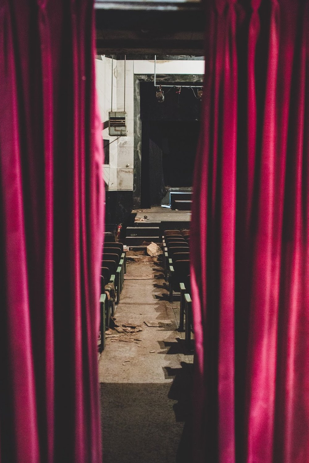 Looking through the original red velvet curtains into the theatre. Help revive the Bells Theatre! - bit.ly/bellstheatre