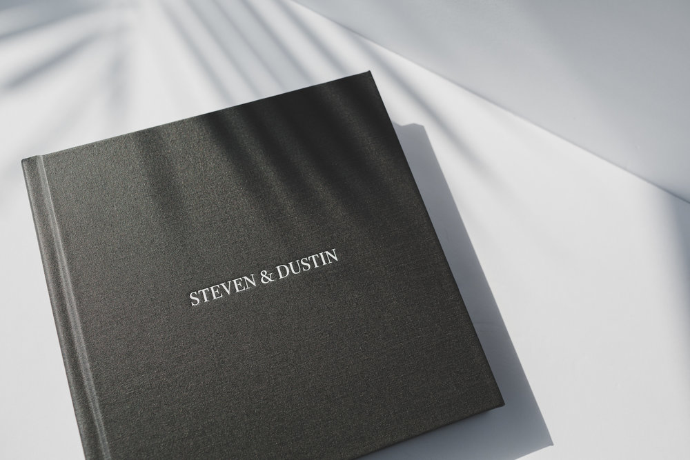 Pictured: Silver Icing Coated Book cloth with White Stamp