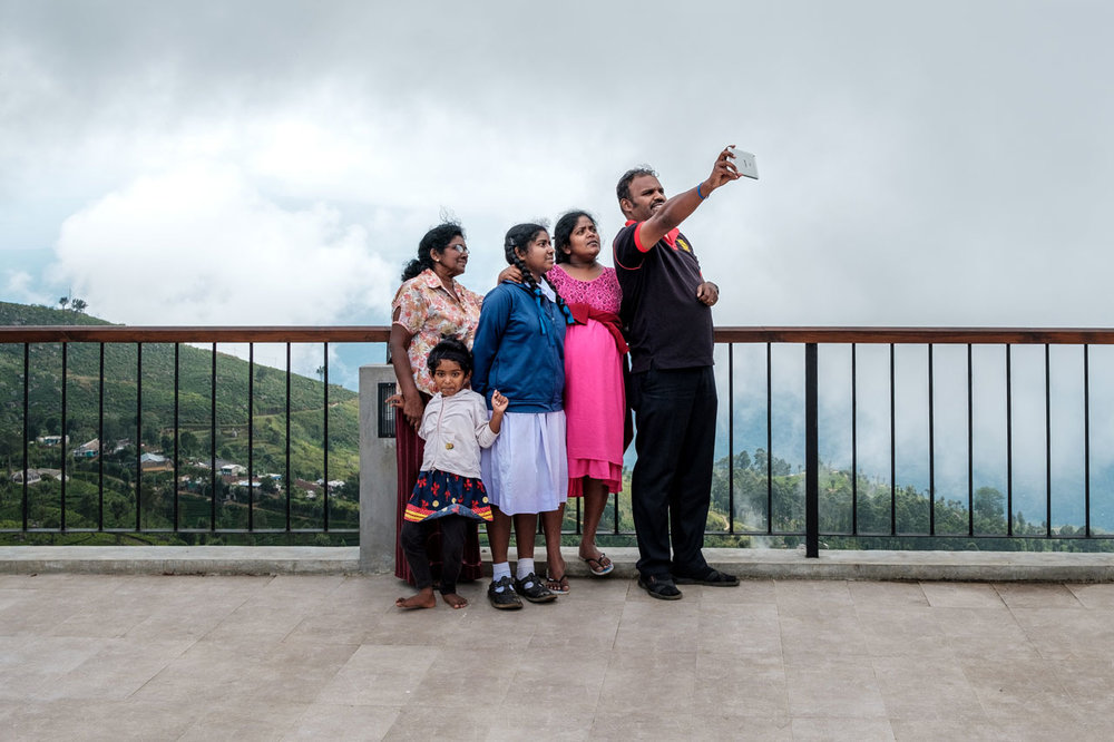 Copy of family taking selfie on viewing platform in haputale sri lanka