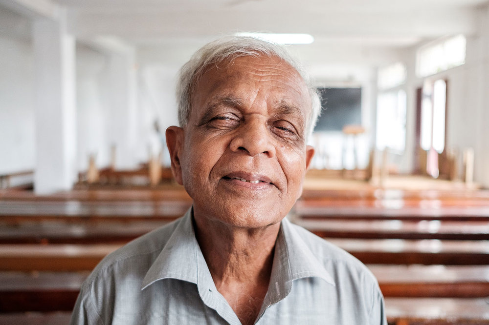 portrait sir lankan man posing in classroom kandy kulturhybrid