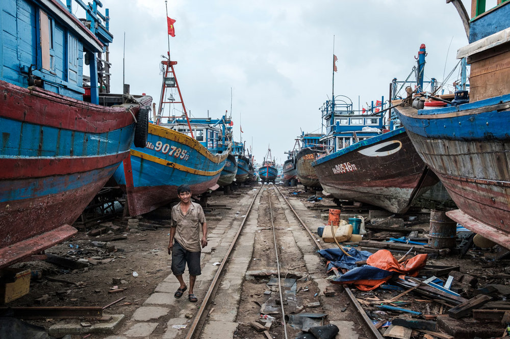 vietnamese harbor full of blue boats in da nang