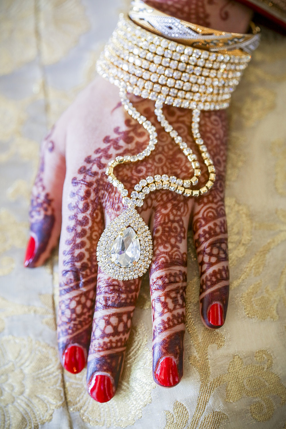 Without a doubt, wedding ceremonies in Pakistan are full of striking, amazing and eye-catching traditions.  I had to dig deeper and learn why the brides hand had drawing in them. I learned this type of art is called Mehndi and it is a form of body art from Ancient India, in which decorative designs are created on a person's body, using a paste, created from the powdered dry leaves of the henna plant.