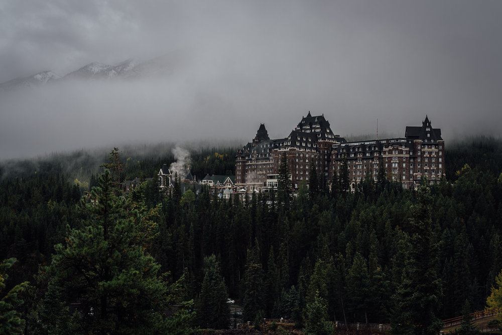 Banff Springs Hotel with mountain backdrop sunrise