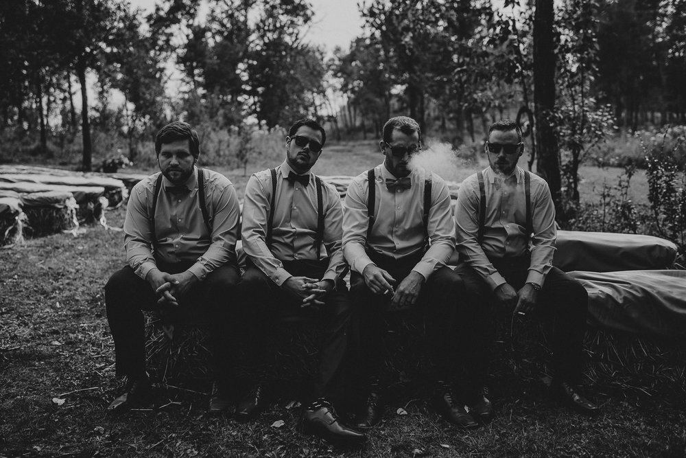 hard looking groomsmen smoking Alberta Intimate Farm wedding calgary banff wedding photographer elopement