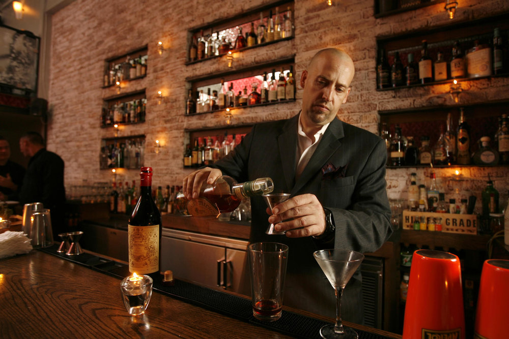 A cocktail master spinning his tricks, photo courtesy of Bourbon & Branch