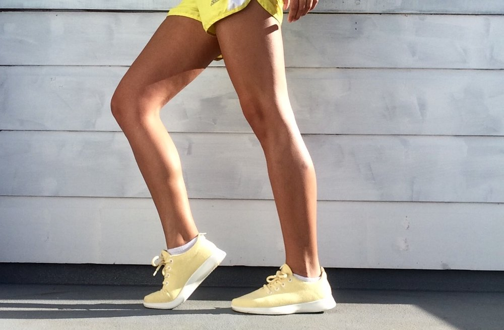 A pair of Allbirds sneakers in yellow! Photo courtesy of Natasa Spasic