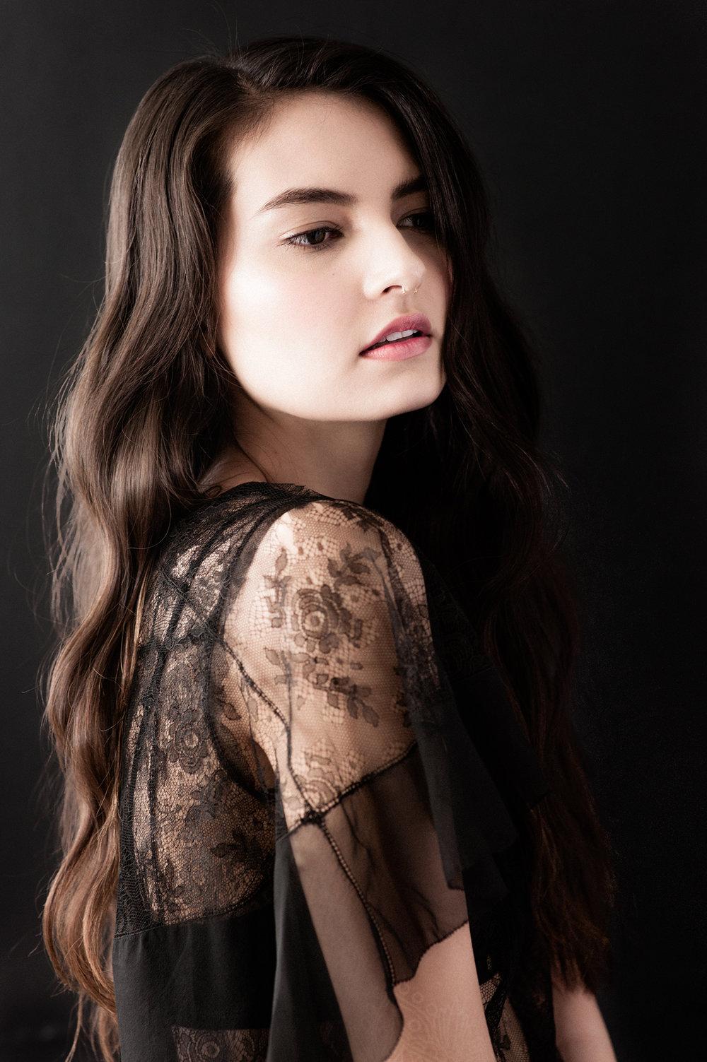 Sydney is wearing a Vintage 1930s Black Lace Dress and Botanica Workshop Aya Longline Bralette.
