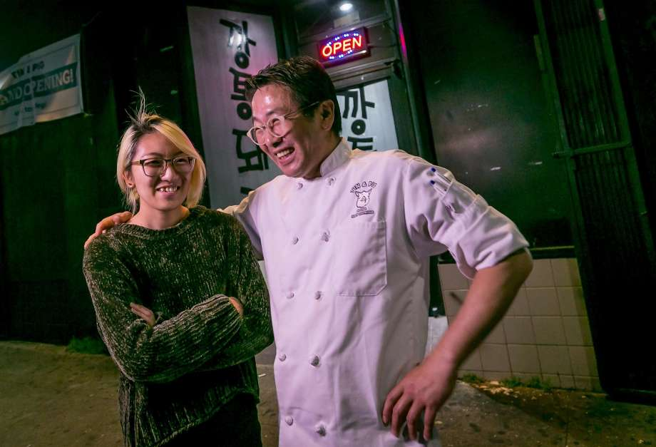 So Choi and her father, Jae Choi, in front of Tin & Pigs, photo via SF Chronicle.