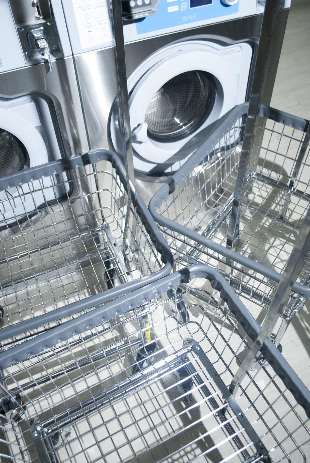 The laundromat space comes with various soaps, dolly carts, and tables to properly clean your clothing.