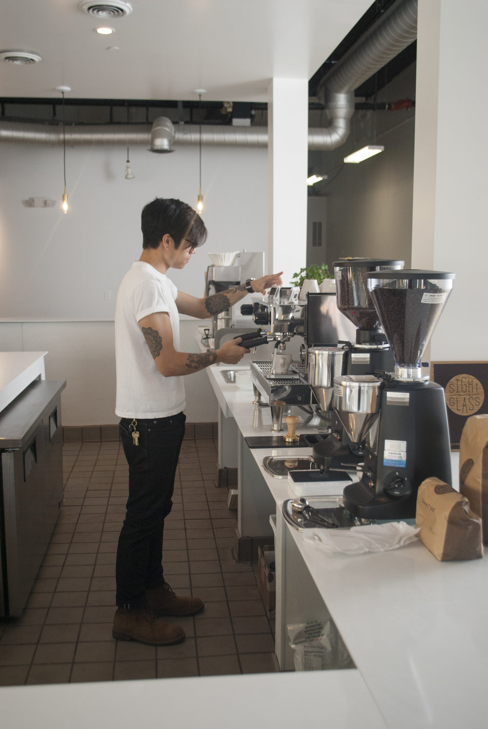 One of the Sightglass in-house baristas making sure the machines are calibrated for opening day.