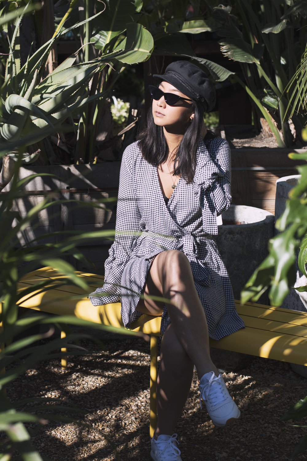 Dress and Coat: Shop Isalis, Hat: Brixton, Sunglasses: Le Specs X Adam Selman, Shoes: Reebok