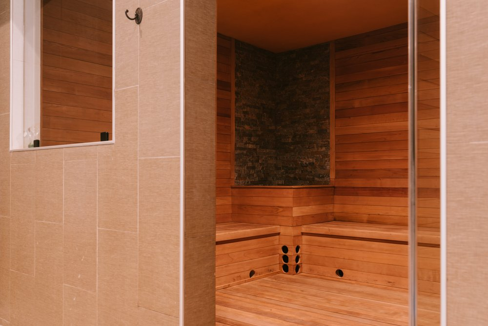 Sweat it out extensively in the steam room.