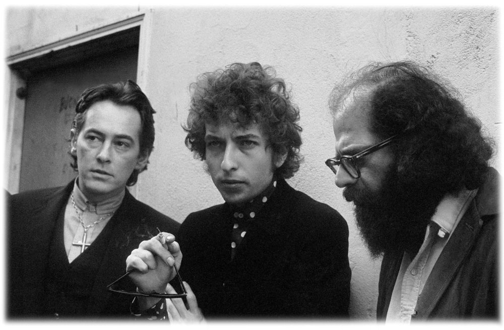 Michael McClure, Bob Dylan and Allen Ginsberg hang out at a party in 1965 following Dylan's concert at the Berkeley Community Theater in California. (Larry Keenan)
