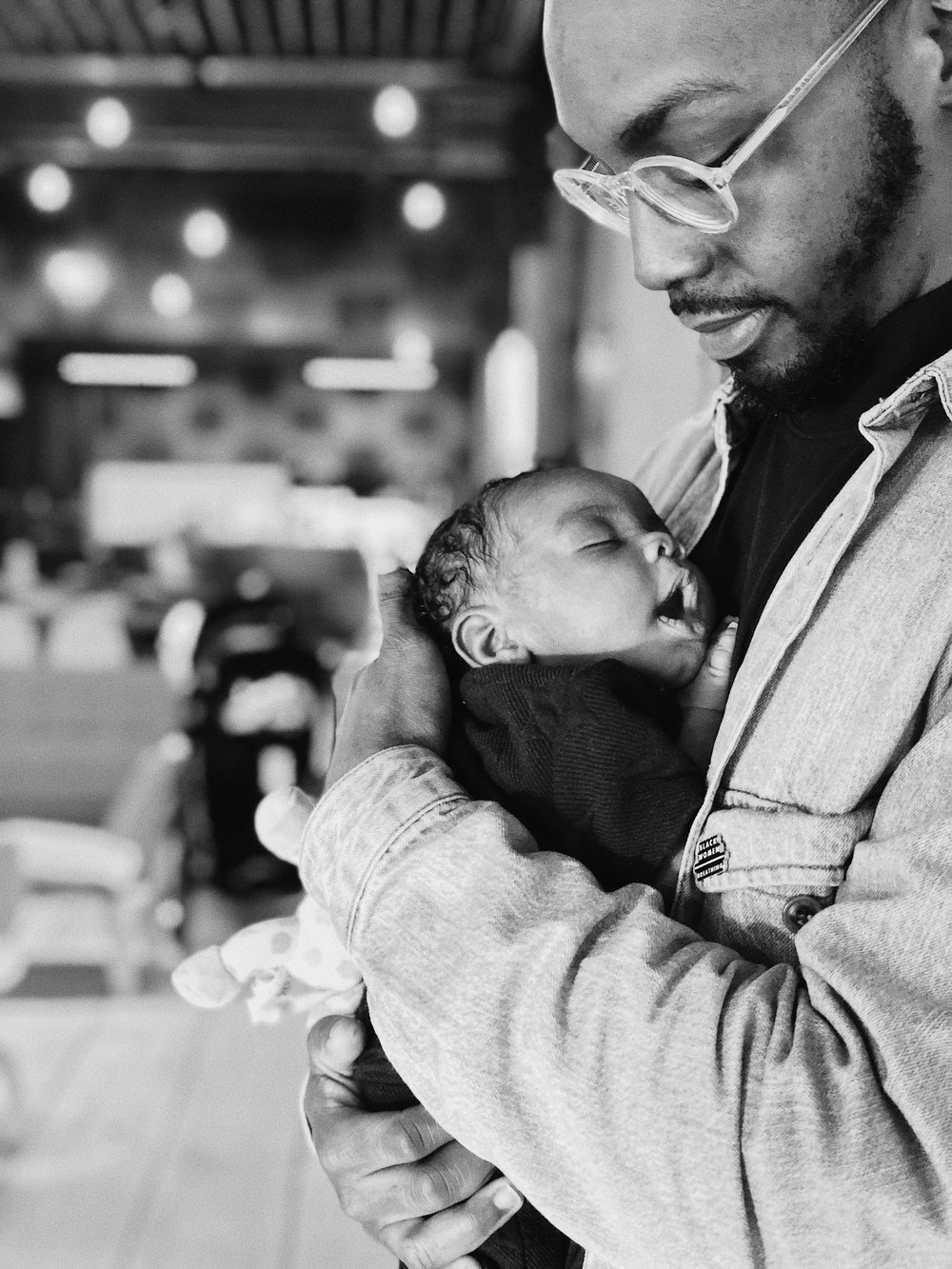 Adrian and his newborn daughter Emory, photo courtesy of Michael Lyon