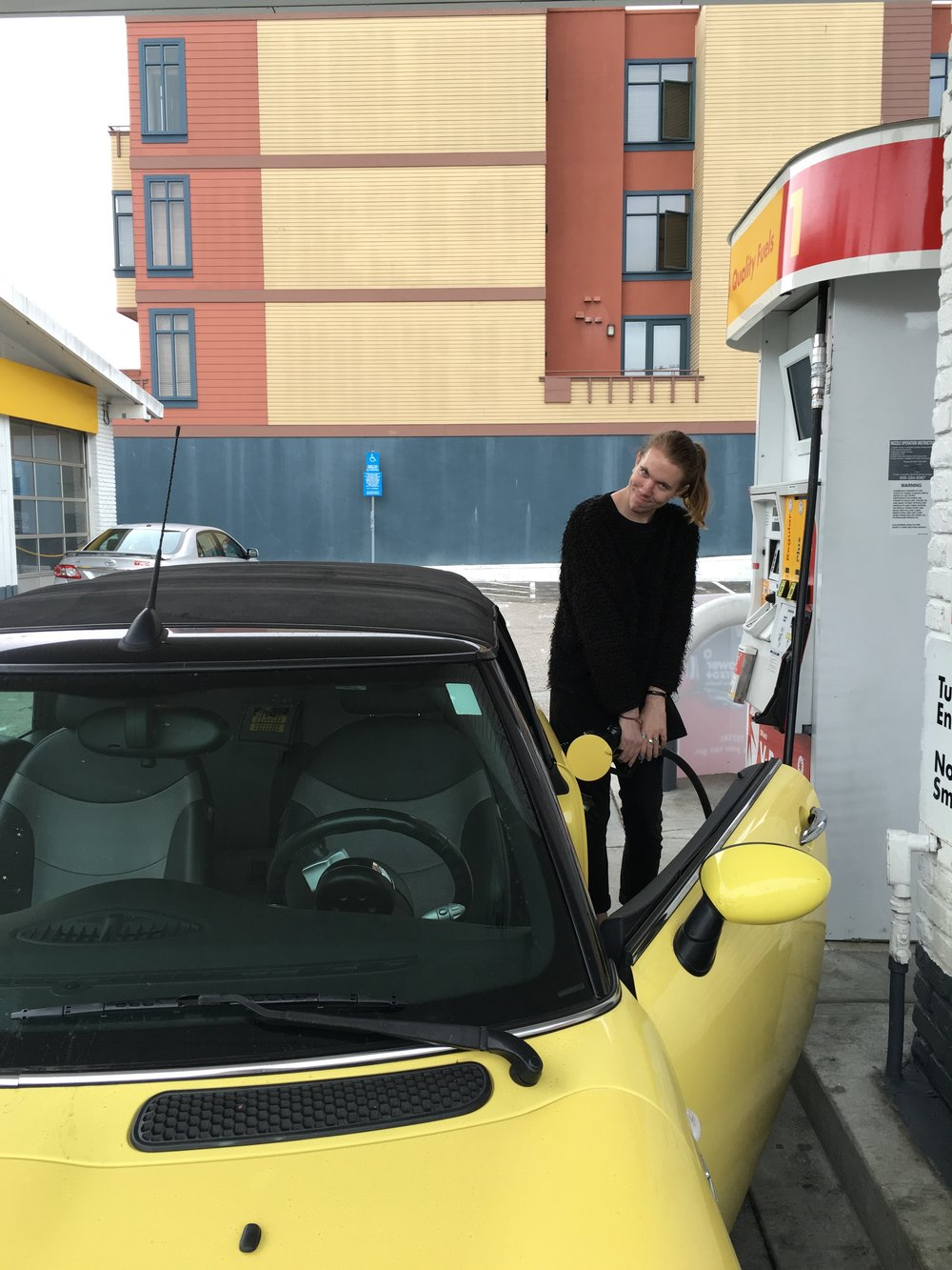 Pumping gas into a Getaround during on sponsored story with the brand.