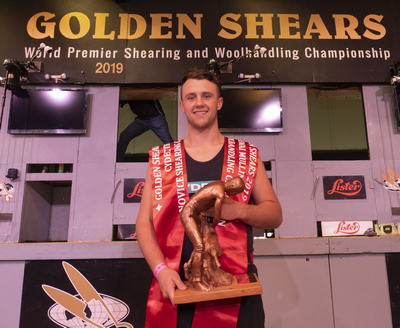 Adam Gordon, of Masterton, with the spoils of a history making two wins on the opening day of the 59th Golden Shears in Masterton. PHOTO/Pete Nikolaison, Golden Shears.