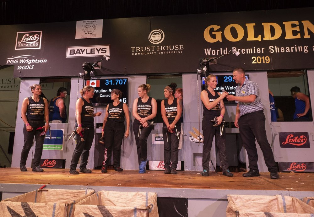 All over baa the shouting...finalists await the reult of the Golden Shears women's shearing final, from left Pauline Bolay (second), winner Emily Welch, Jills Angus Burney (5th), Laura Bradley (4th), Jackie Paku (6th) and Sarah Higgins (4th).  PHOTO/Pete Nikolaison, Golden Shears.