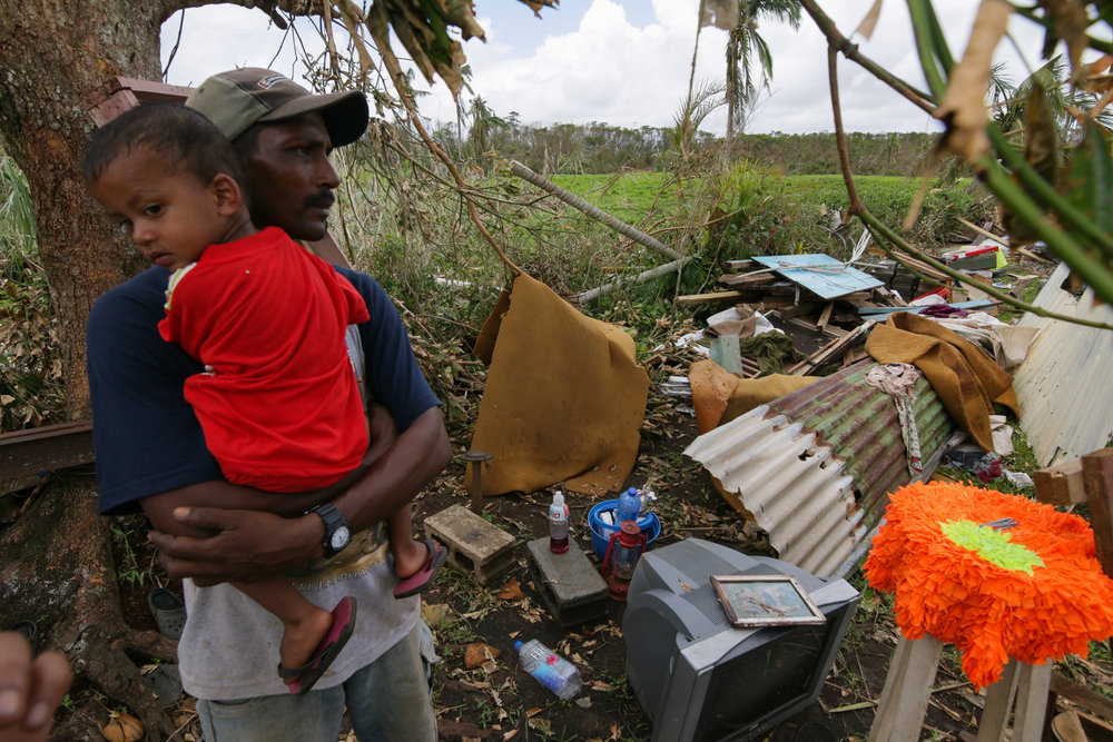A resident of the Madhuvani settlement in Rakiraki looks at the damage caused to his home after Cyclone Winston swept through the area and made landfall in Fiji on February 20, 2016.
