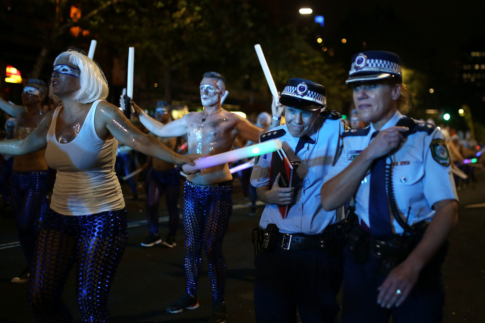 An Australian policewoman dodges a glow stick being waved by a participant during the annual Sydney Gay and Lesbian Mardi Gras parade in Sydney, Australia, March 4, 2017.
