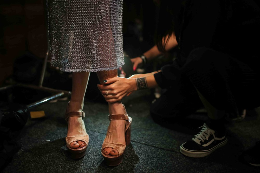 A model for We Are Kindred is prepared for a runway show back stage during Fashion Week Australia in Sydney, Australia.
