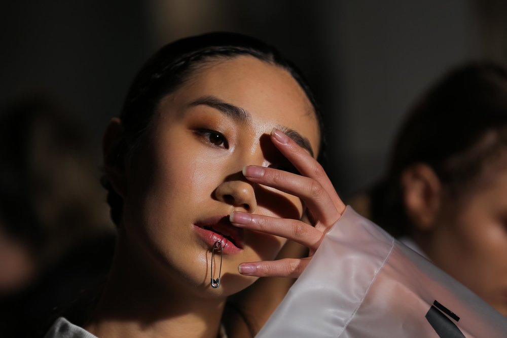 A model in the ANX show poses for a picture back stage at Fashion Week Australia in Sydney, Australia.