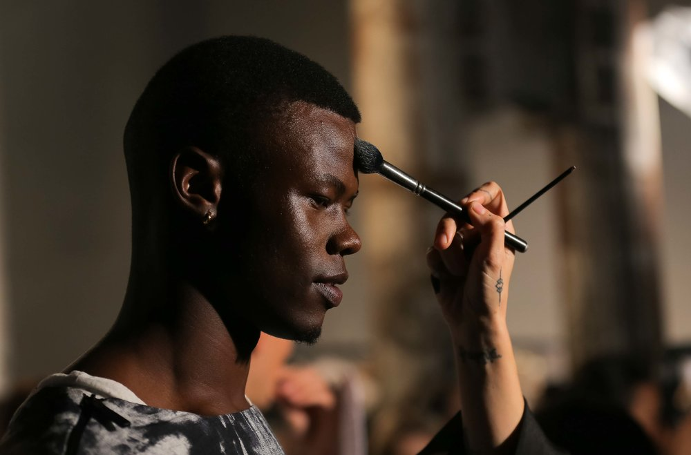 A male model in the ANX show has makeup applied back stage at Fashion Week Australia in Sydney, Australia.