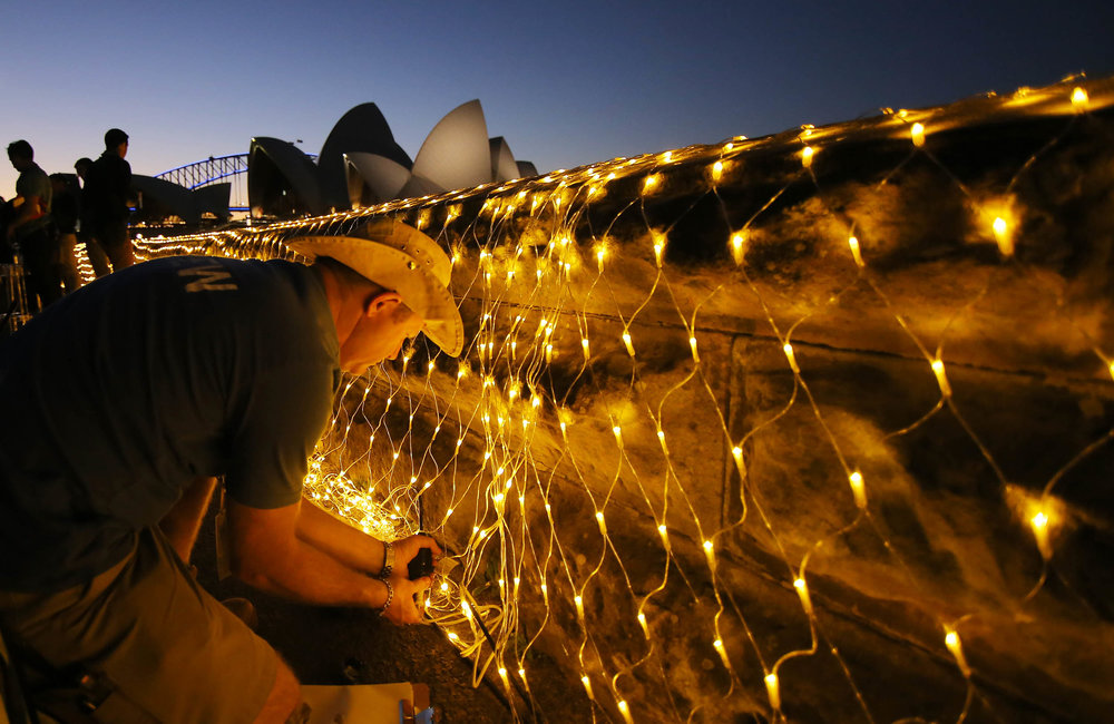 Last minute repairs are made to lights before a preview of Vivid Sydney festival of light and sound at The Royal Botanic Gardens in Sydney, Australia May 24, 2017.