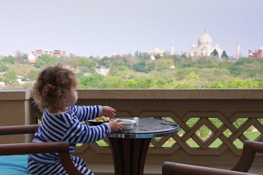 Gazing out towards the Taj Mahal, while enjoying chopped banana and oats.