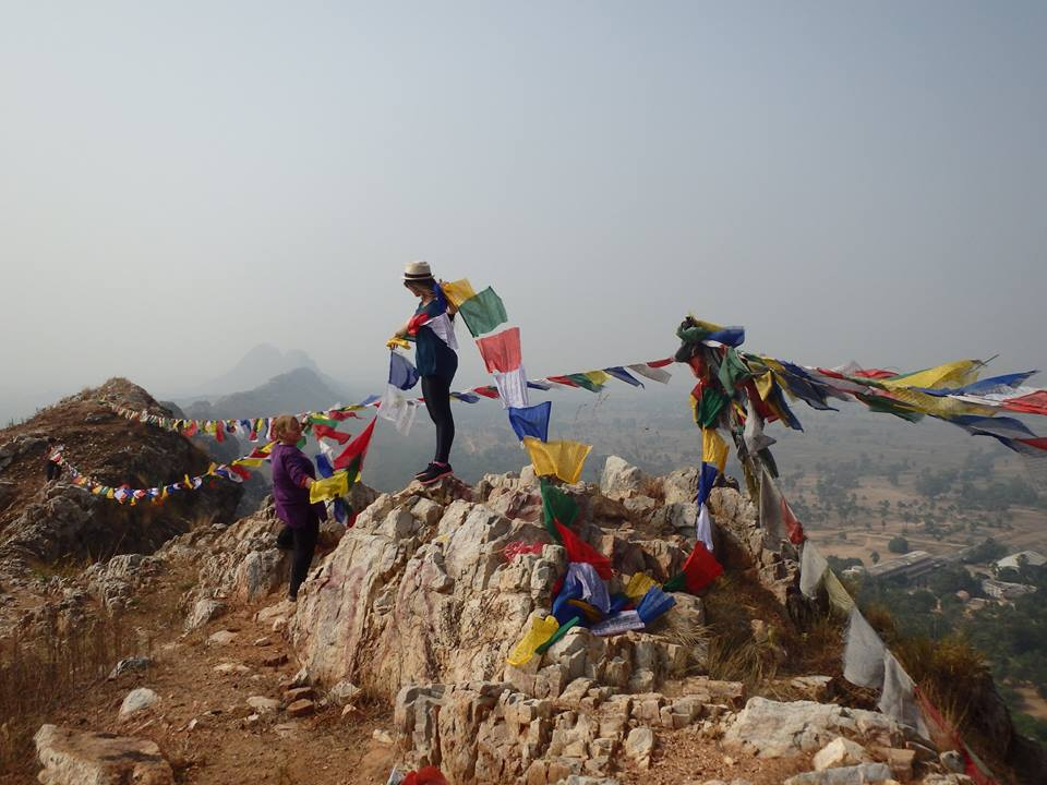 Leading a pilgrimage to Mahakala Cave. Prayer flags offering