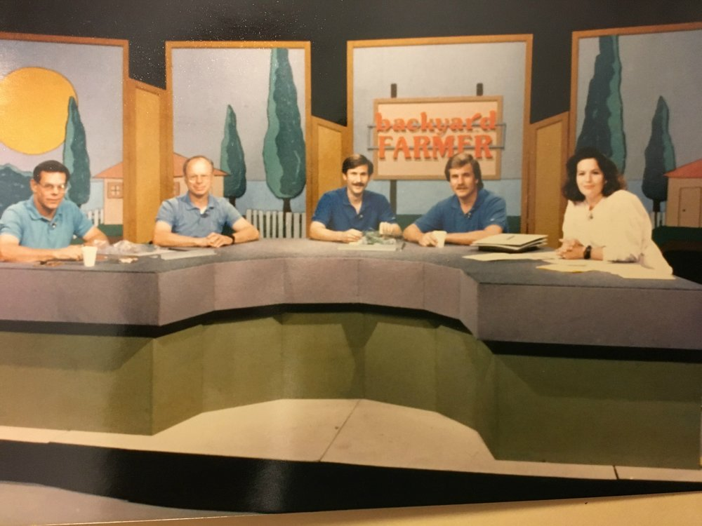The cast and set of Backyard Farmer, sometime in the late 1980s. From left to right are the respected scientists who answered viewers' questions; a plant pathologist, a horticulturalist, an entomologist and another plant pathologist. I'm the one with what I'm sure I thought was some kind of anchor-girl hair, a pink sweatshirt and a big black plastic watch. What was I thinking? (Credit: NET)