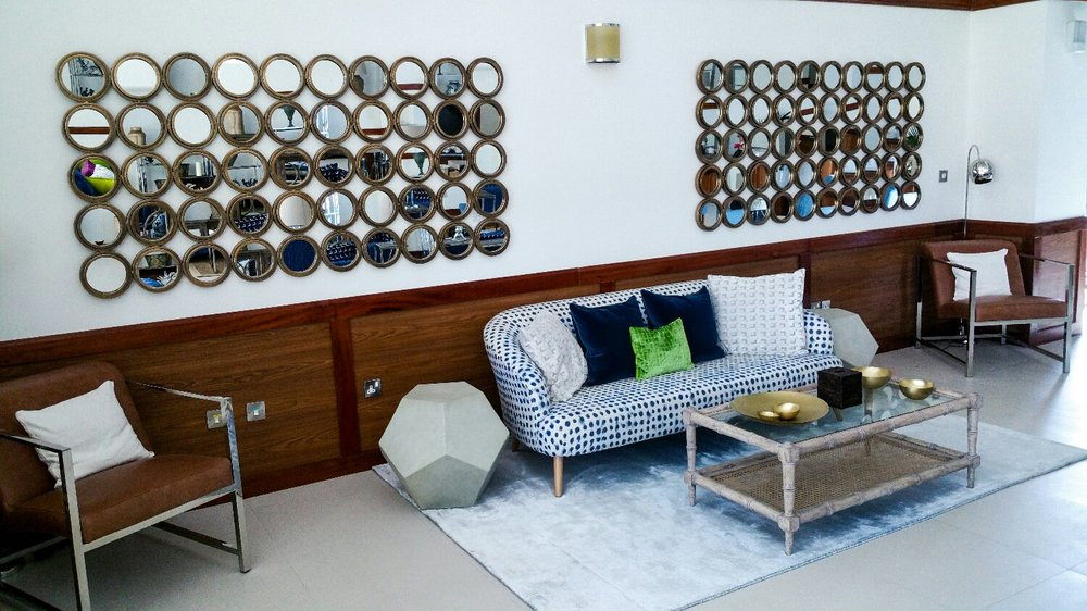 The mirror display lining this wall reflect all areas of the lounge like a mosaic of the decorations.