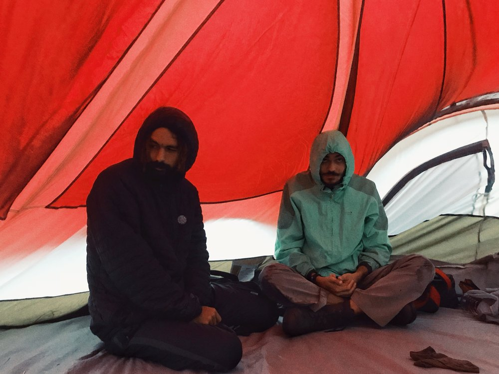 05:57am p.c.:Tolga Akcayli - Kai and I holding the tent up with our backs.