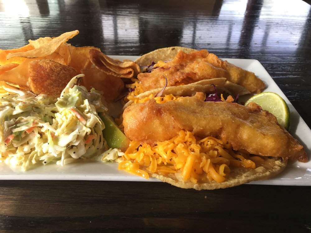 Fish tacos with coleslaw and house-made chips at the Brigantine.