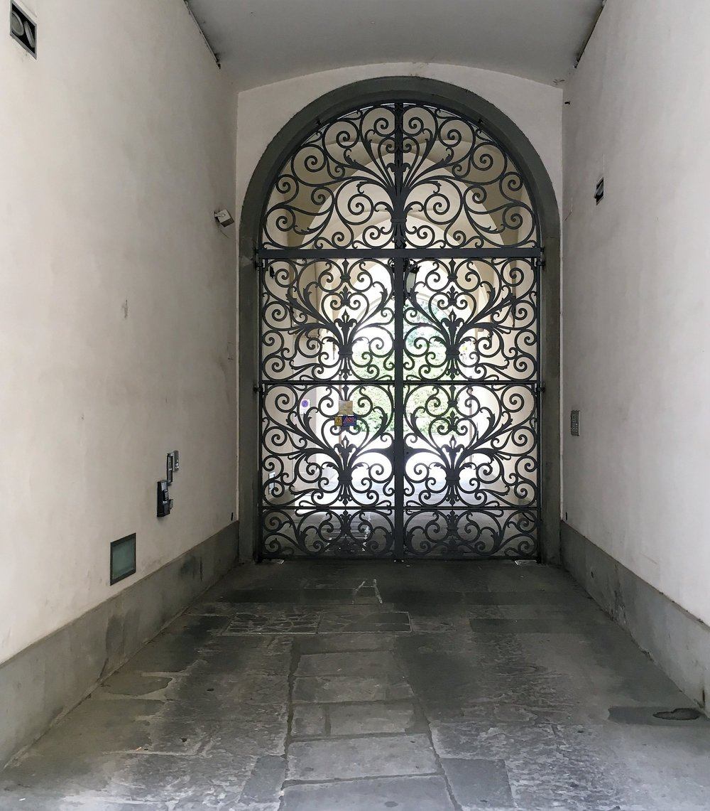 A gate at the entrance of a courtyard in Florence, April 2016.