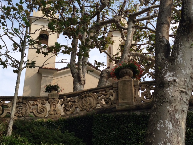 The villa incorporates a tower from an earlier Franciscan monastery, seen here through the trees above a beautiful carved balustrade that winds its way through the terraced gardens.