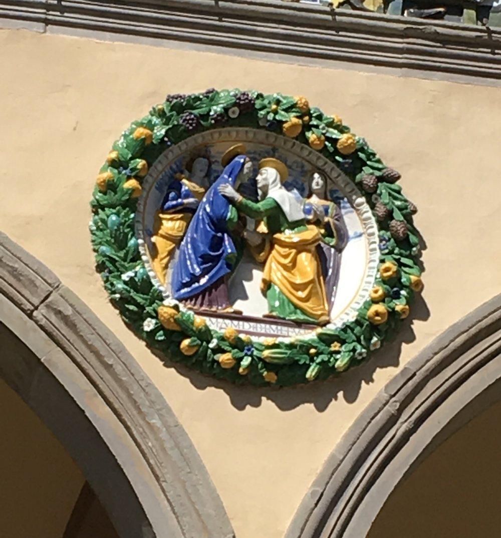 Tondo on the facade of the Ospedale del Ceppo.