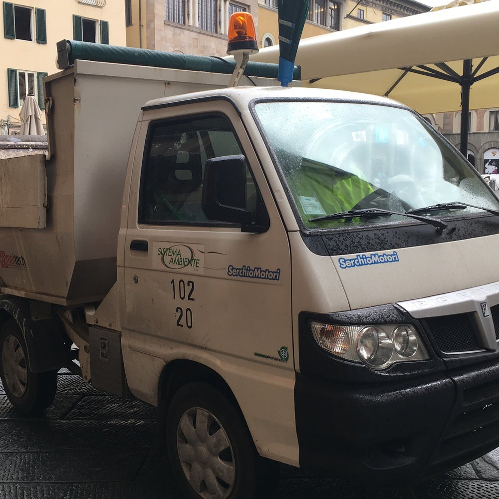 These small trucks make the rounds and quickly pick up those street side bags of trash.