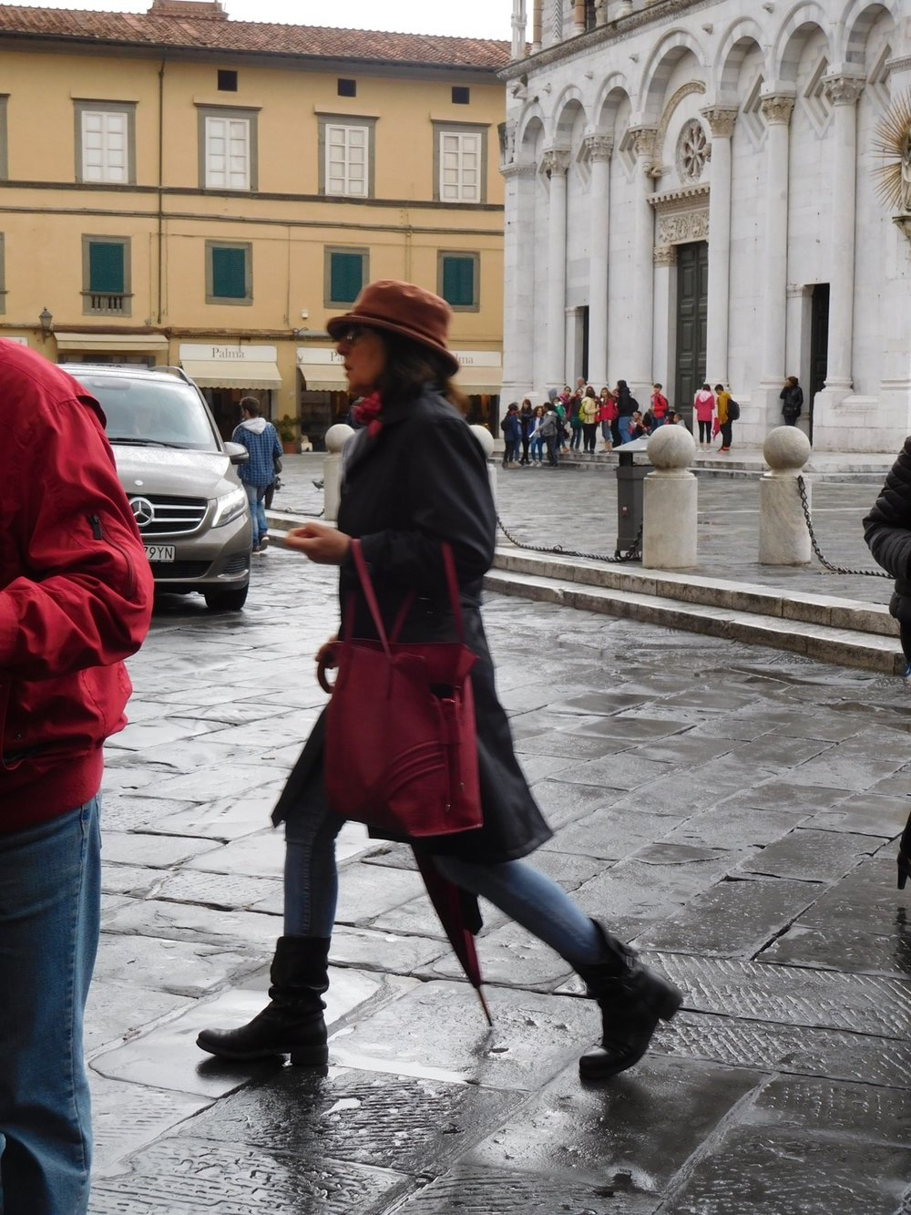 Italians look stylish, even in raingear.