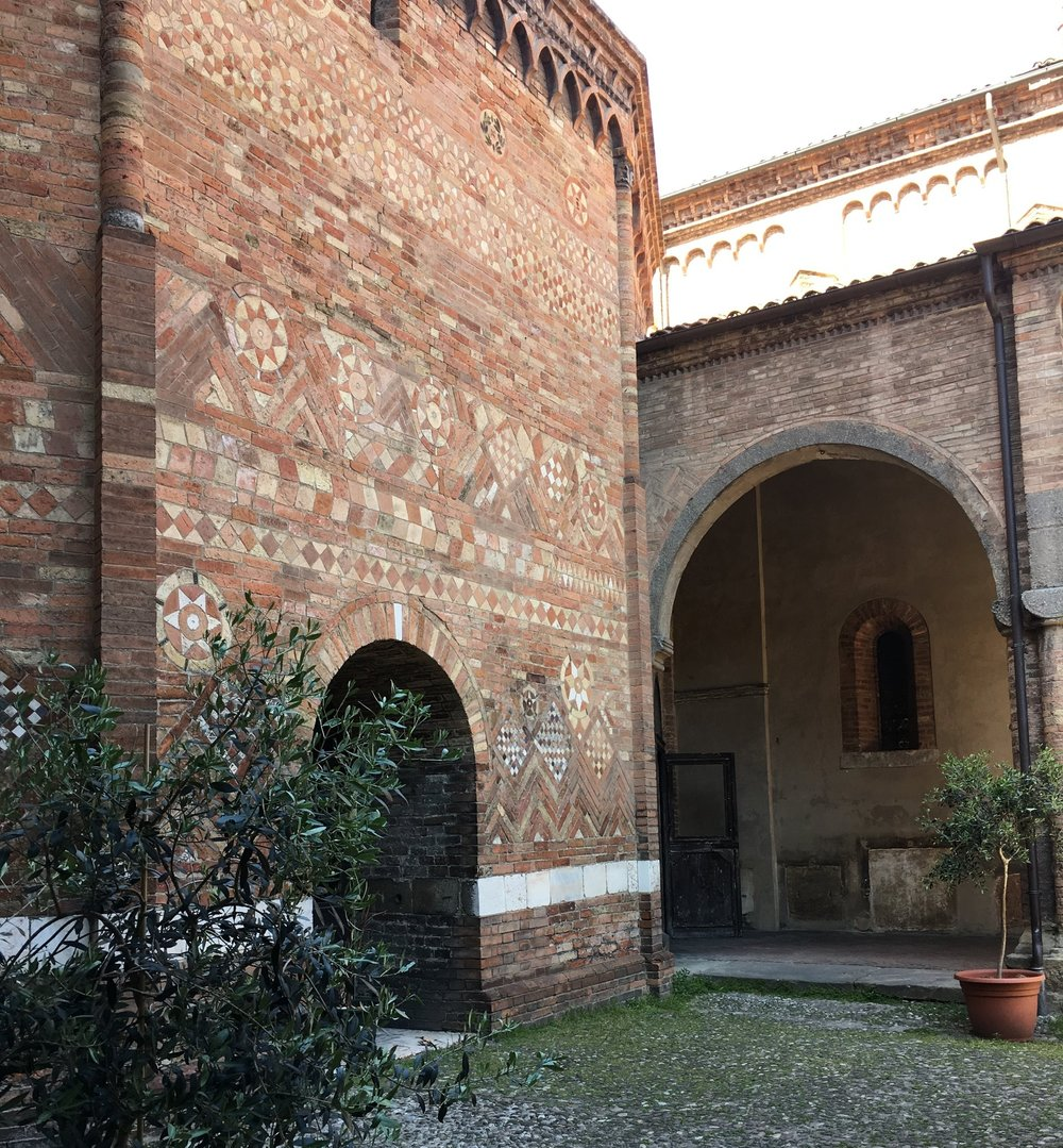 Intricate brickwork in the Pilate's Courtyard, between two of the churches in the Santo Stefano complex.