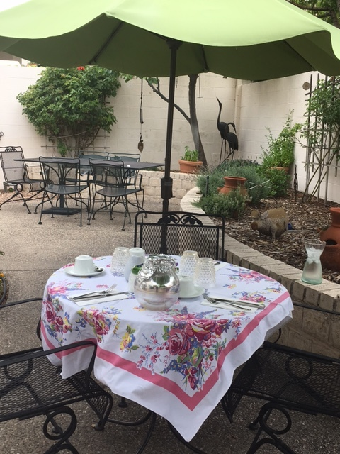 The table is set for brunch on the patio.