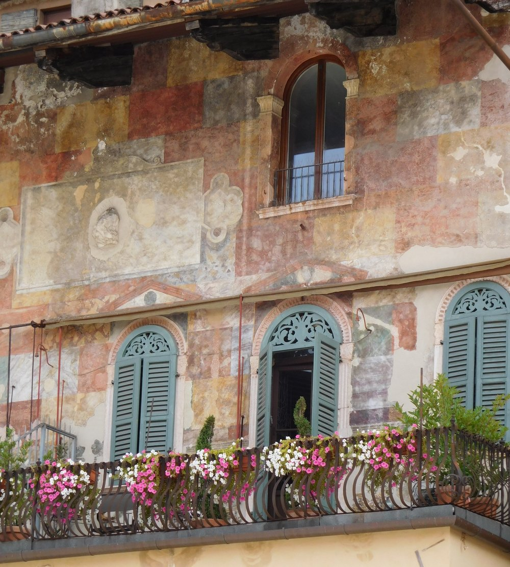 The Mazzanti Houses are covered with old (15th or 16th century) frescoes and lined with charming flower filled-balconies.