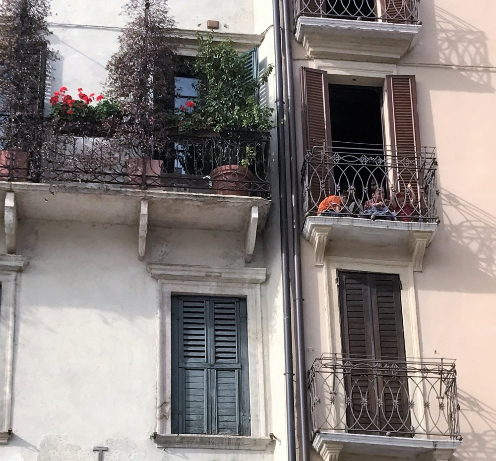 Children in Verona have an enviable view from a small balcony that overlooks Piazza delle Erbe.