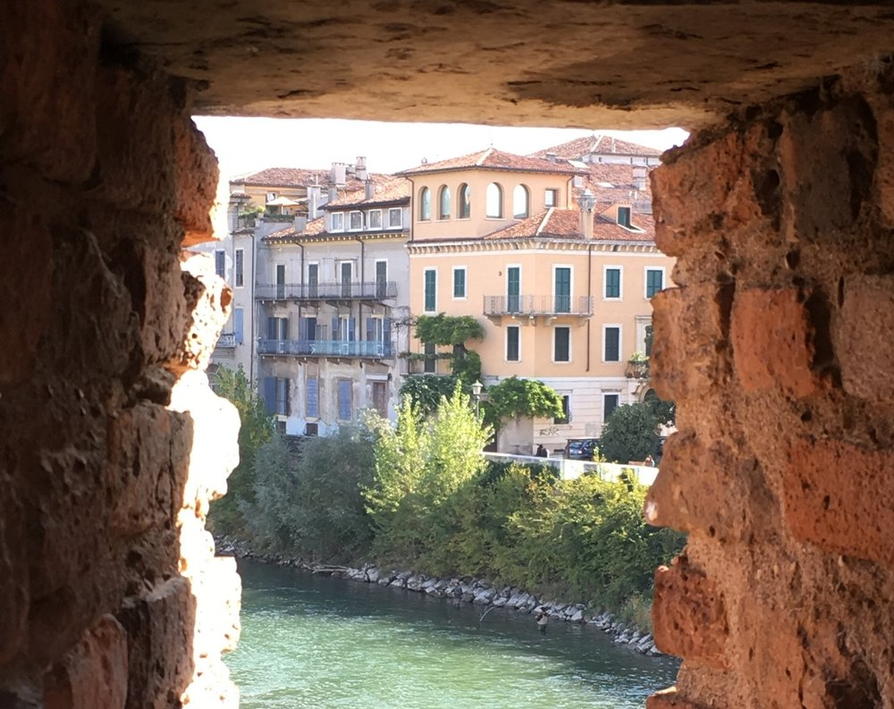 The city of Verona, viewed from an opening in the Ponte Scaligero.